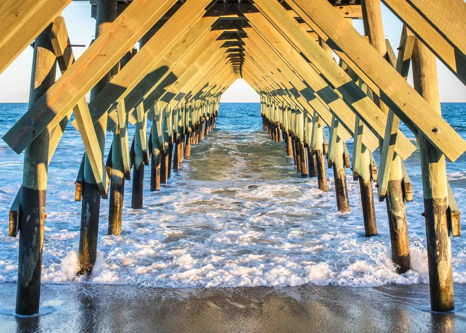 Waters lapping the pier at Wrightsville Beach