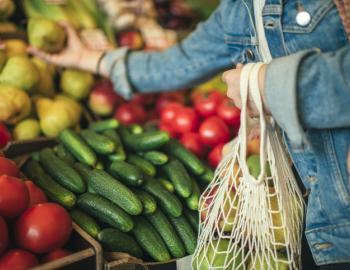 women in jean jacket shopping at farmers market