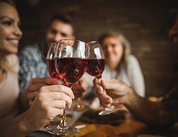 Friends drinking red wine together