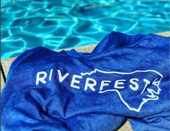 Riverfest towel next to the pool