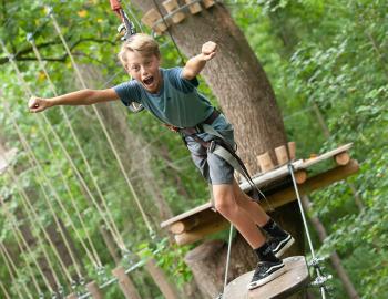 Young boy getting ready to go ziplining