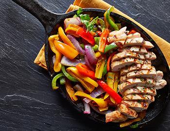 Chicken Fajitas in a cast iron pan