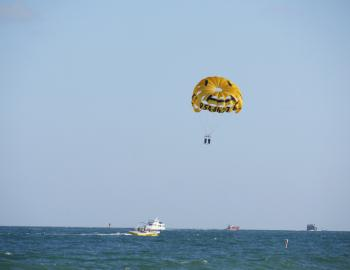 people parasailing off a boat