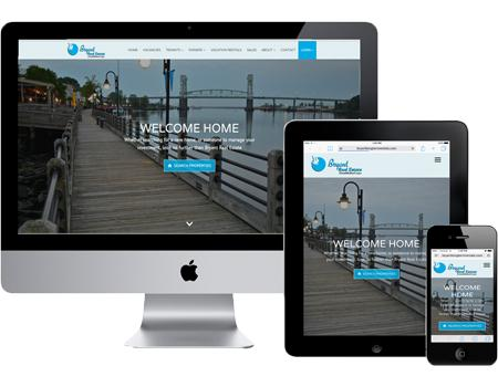 Computer and tablet with Bryant Real Estate Website