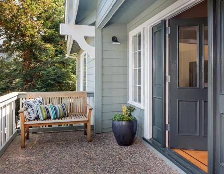 Front porch entrance with bench