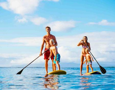 Family paddle boarding in North Carolina