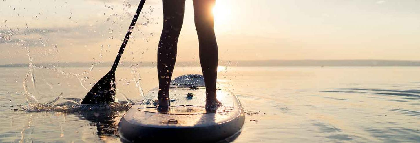 Stand Up Paddle Board racer in the water