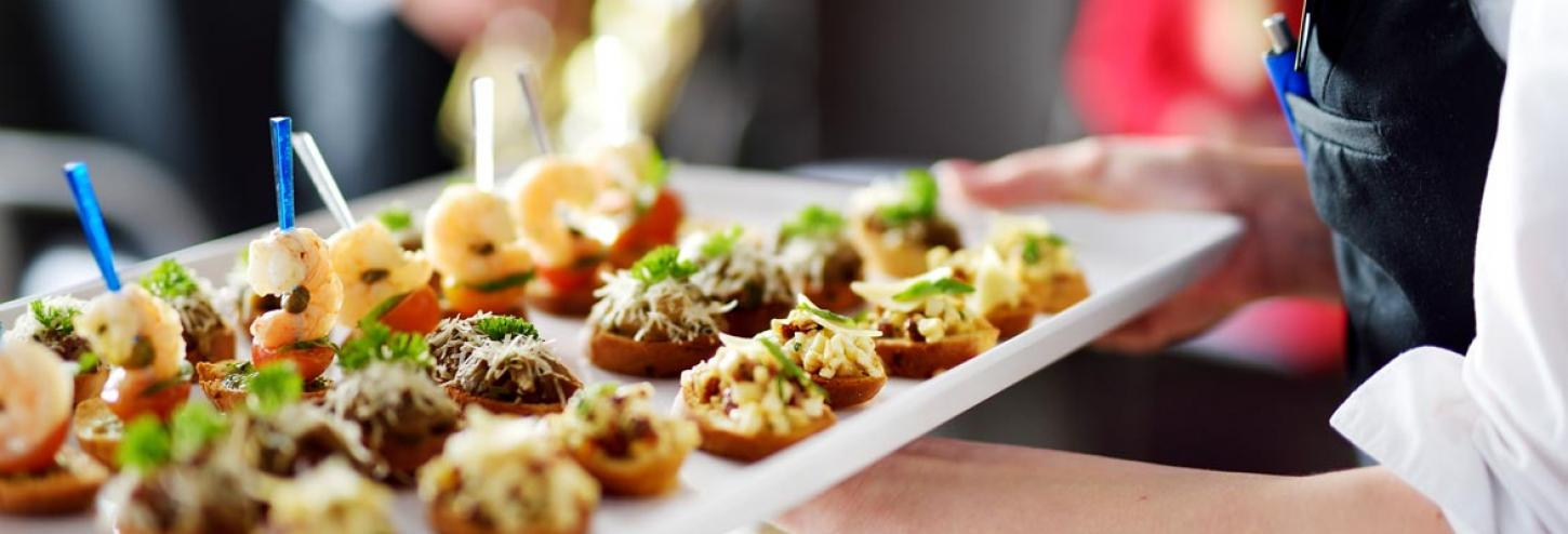 Waiter carrying tray of hors d'oeuvres