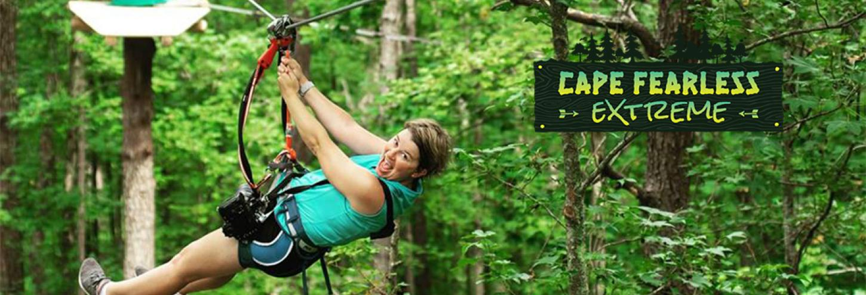 Zip-lining through woods in southeast region of North Carolina