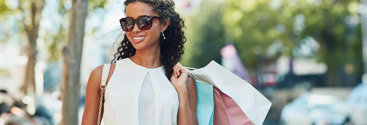 Happy lady holding shopping bags