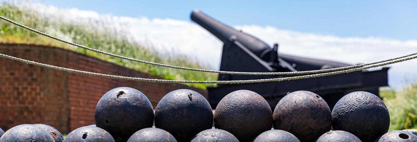 Historical cannon and cannon balls