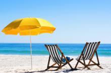 beach chairs with yellow umbrella