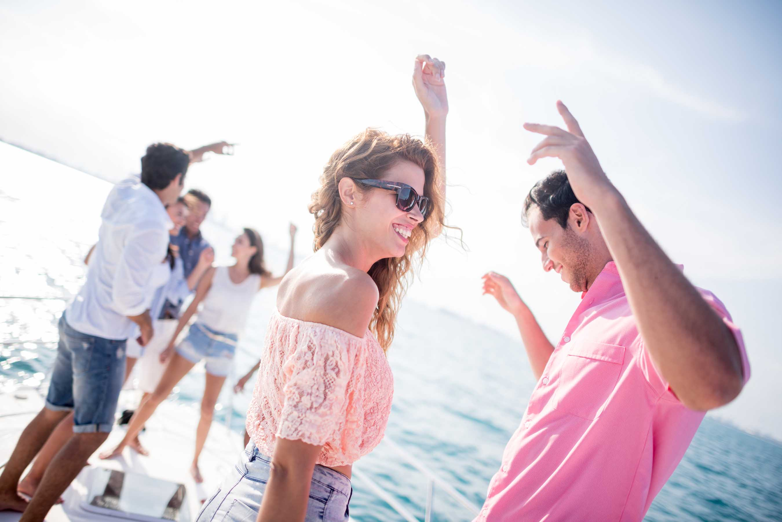 Dancing outside by a yacht