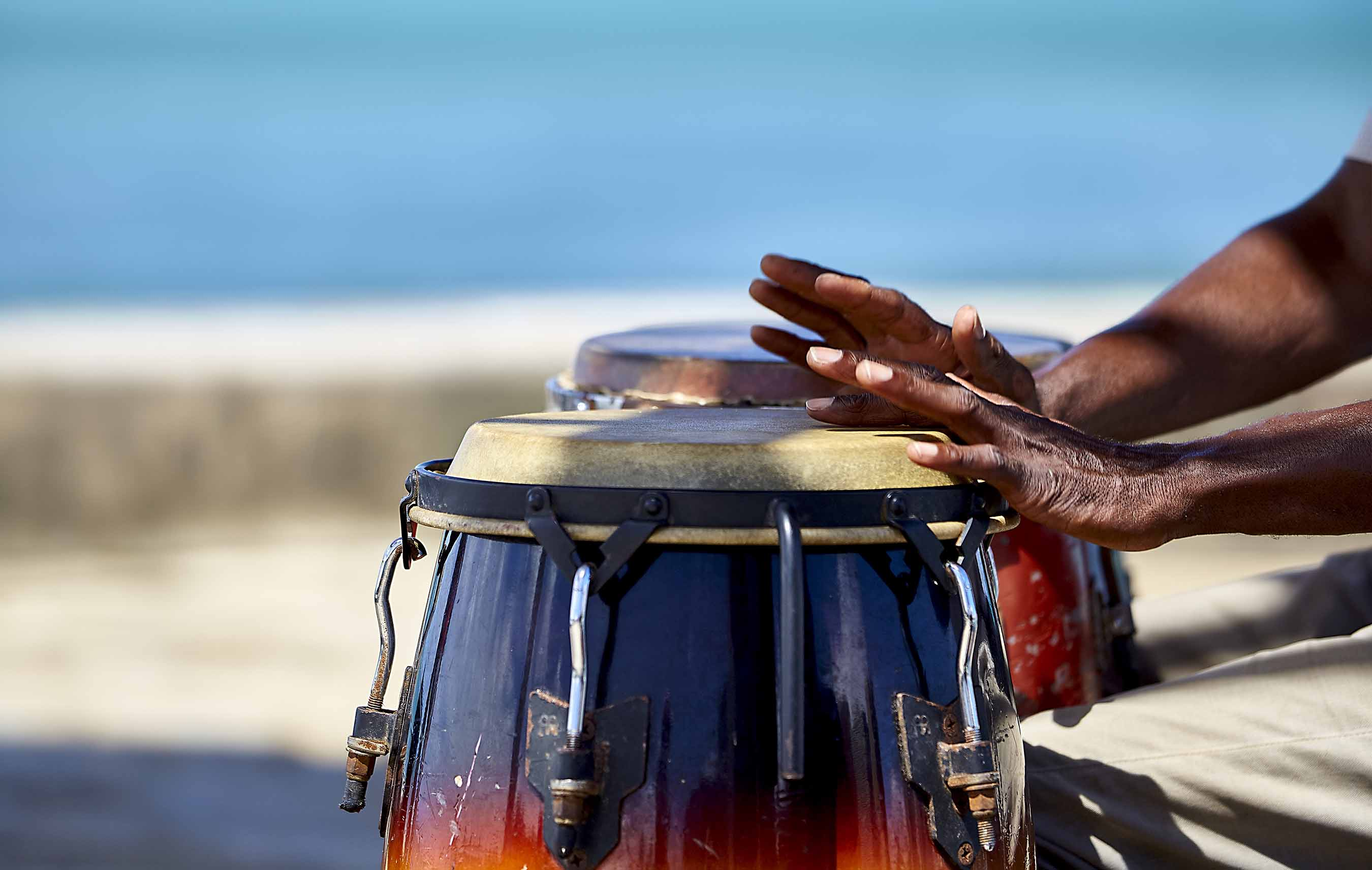 Hands beating on a hand drum