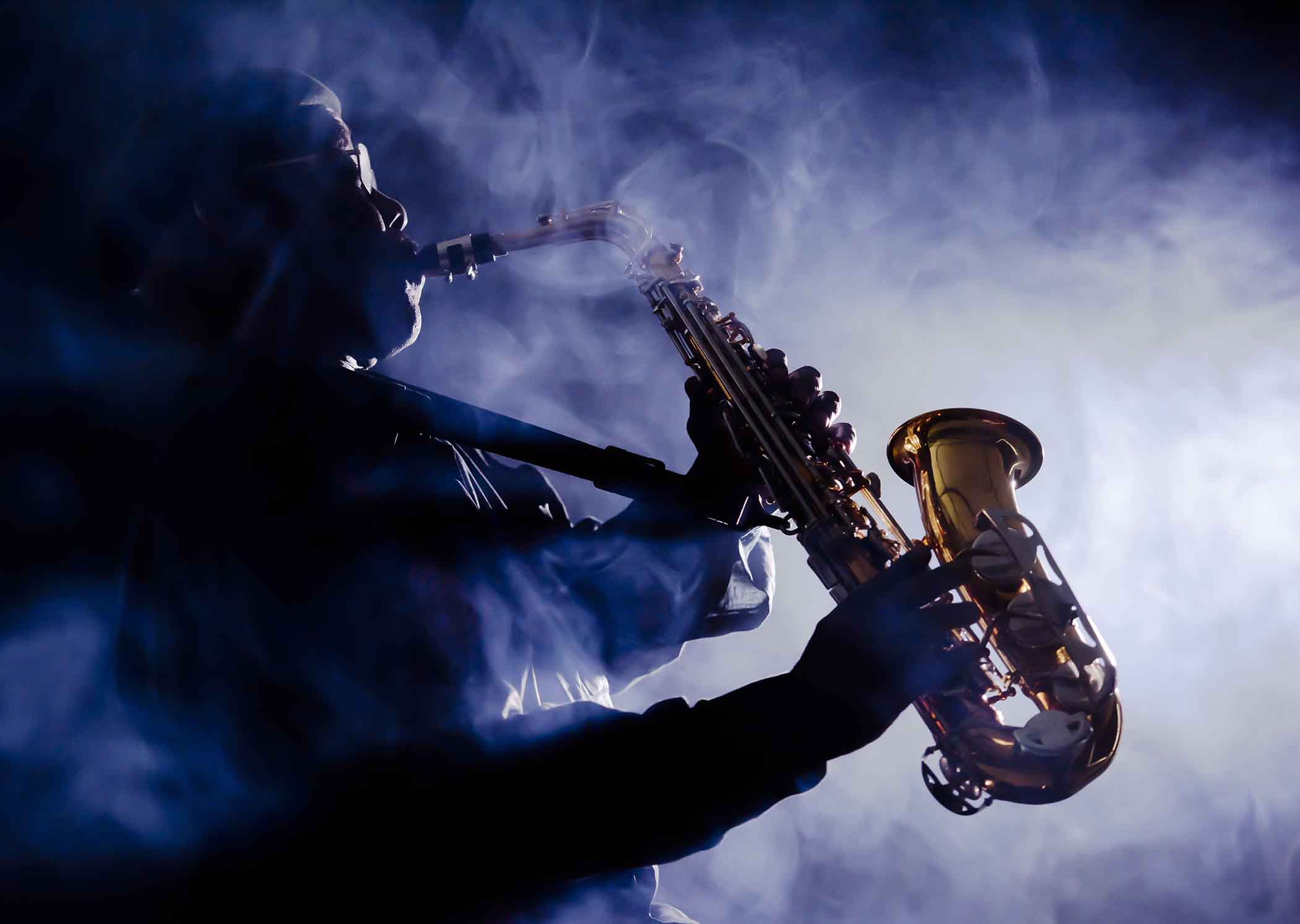 Jazz musician playing with smoke in the air