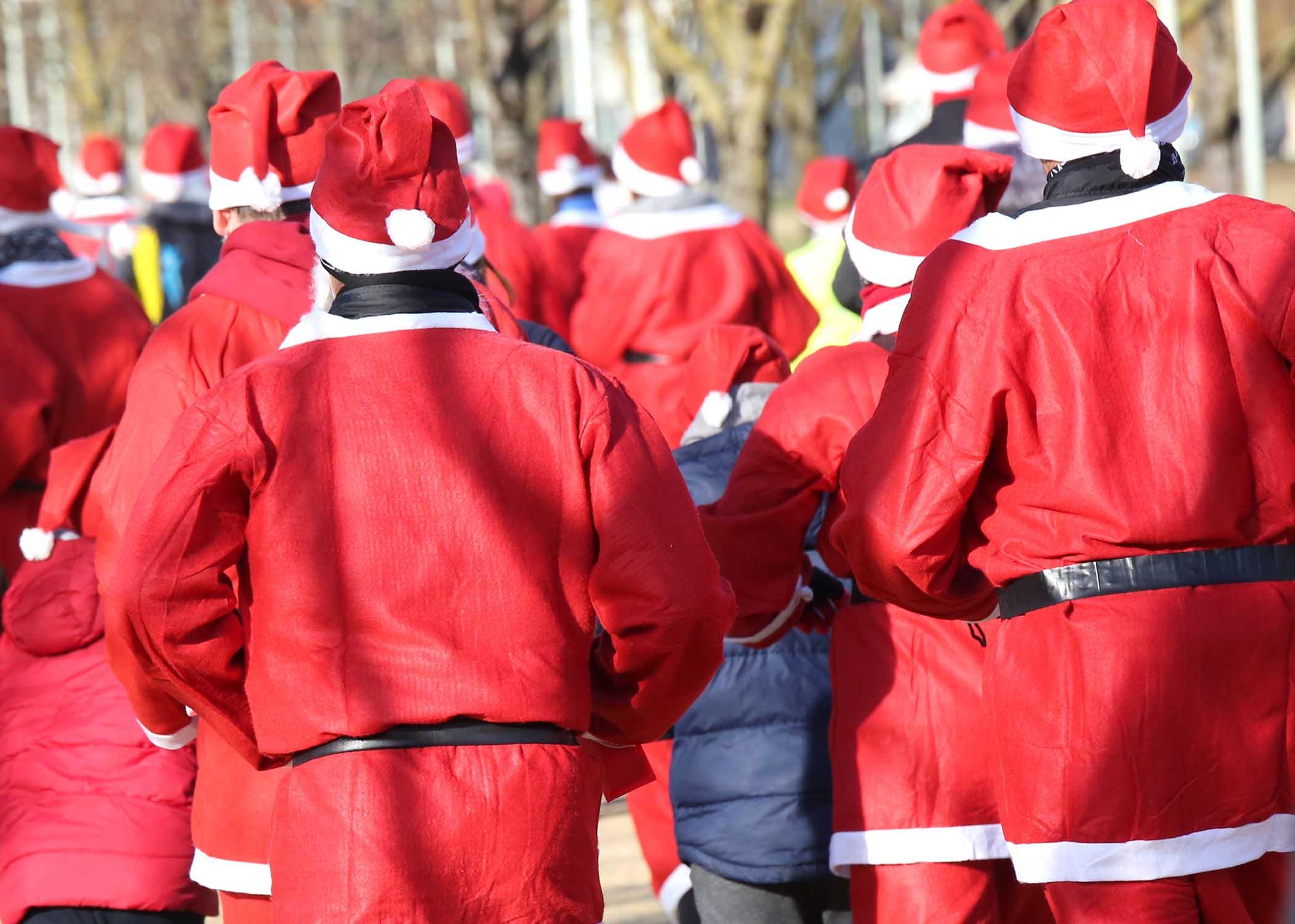 People dressed as Santa racing