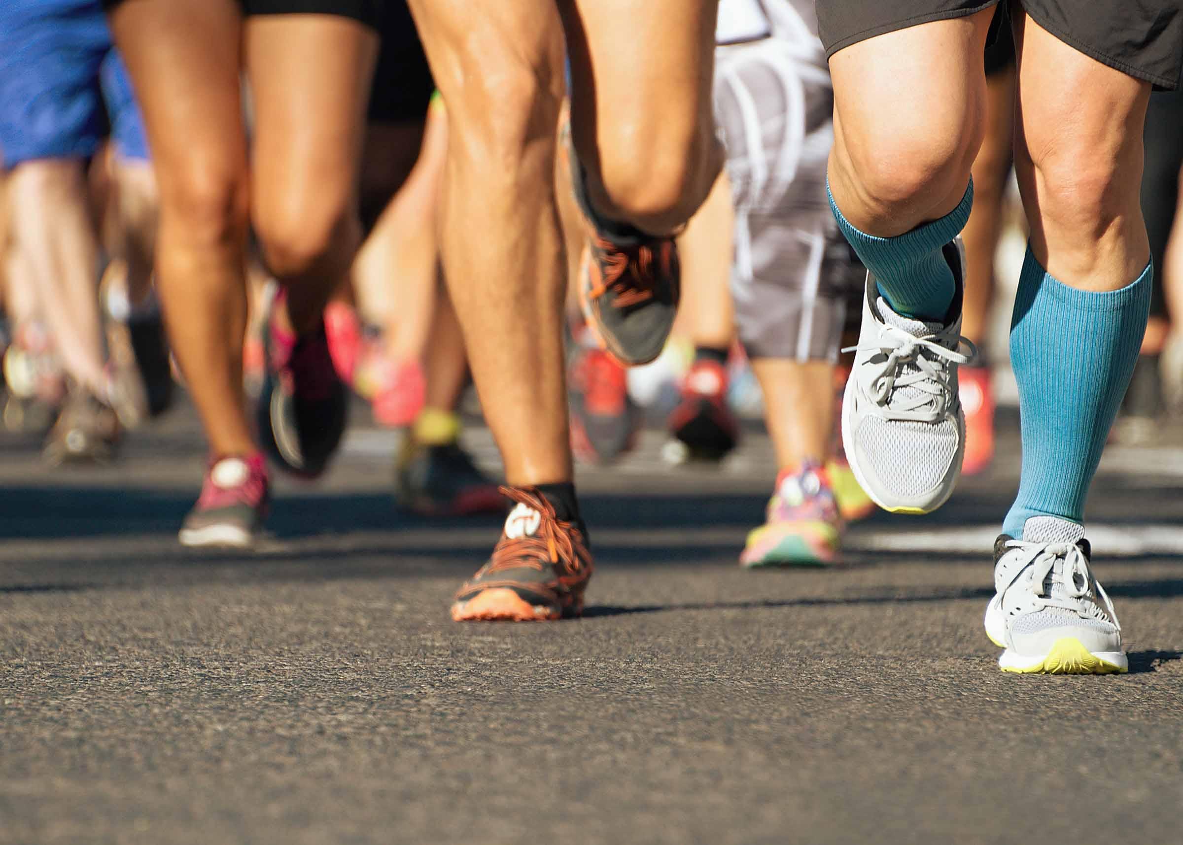 Feet of people racing